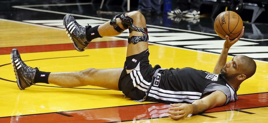 San Antonio Spurs' Tim Duncan stretches during practice Saturday, June 8, 2013, at American Airlines Arena in Miami, Fla. (Edward A. Ornelas / San Antonio Express-News)