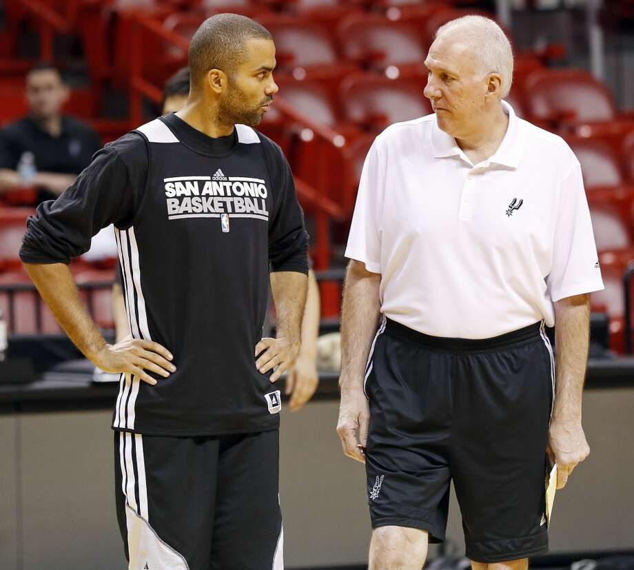 San Antonio Spurs' Tony Parker and head coach Gregg Popovich talk during practice Saturday, June 8, 2013, at American Airlines Arena in Miami, Fla. (Edward A. Ornelas / San Antonio Express-News)