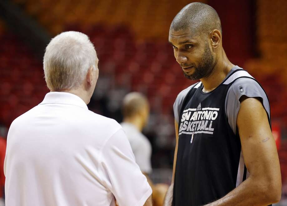 San Antonio Spurs head coach Gregg Popovich and San Antonio Spurs' Tim Duncan talk during practice Saturday, June 8, 2013, at American Airlines Arena in Miami, Fla. (Edward A. Ornelas / San Antonio Express-News)