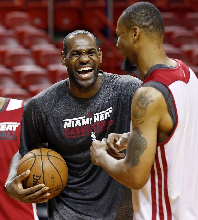 Miami Heat's LeBron James and Rashard Lewis joke during practice Saturday, June 8, 2013, at American Airlines Arena in Miami, Fla. (Edward A. Ornelas / San Antonio Express-News)