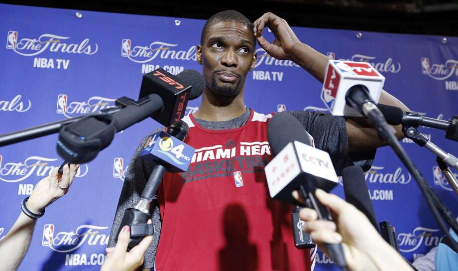 Miami Heat's Chris Bosh answers questions from the media during practice Saturday, June 8, 2013, at American Airlines Arena in Miami, Fla. (Edward A. Ornelas / San Antonio Express-News)