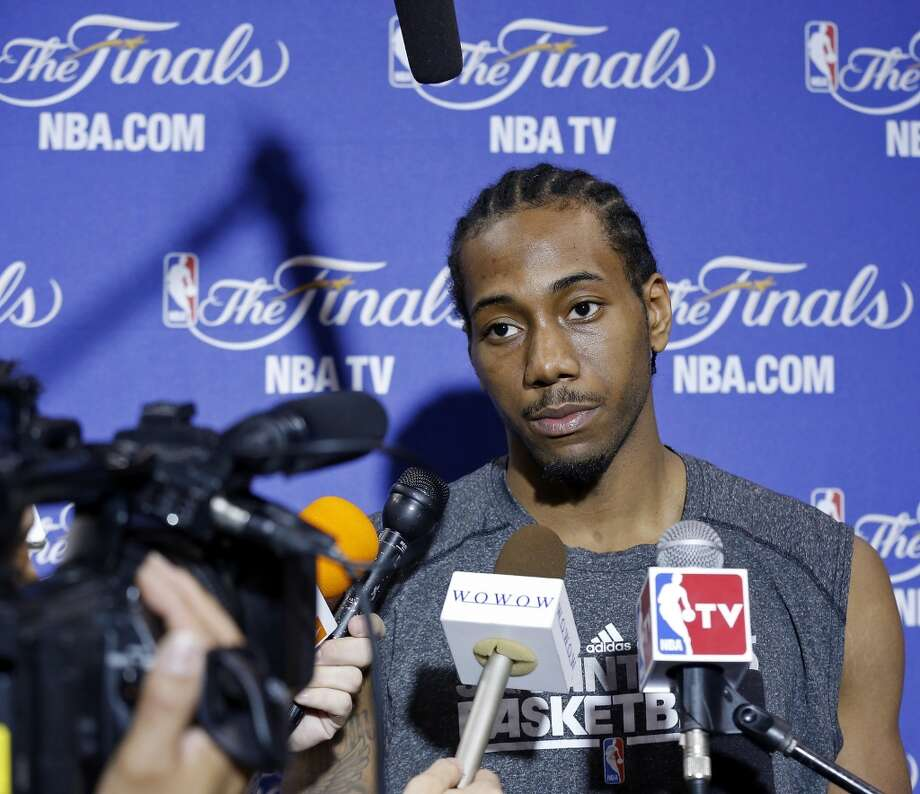San Antonio Spurs' Kawhi Leonard answers questions from the media during practice Saturday, June 8, 2013, at American Airlines Arena in Miami, Fla. (Edward A. Ornelas / San Antonio Express-News)
