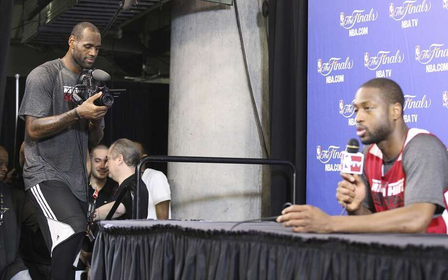 Miami Heat's LeBron James (left) films teammate Dwayne Wade during practice and media sessions at the American Airlines Arena in Miami on Saturday, June 8, 2013. (Kin Man Hui / San Antonio Express-News)