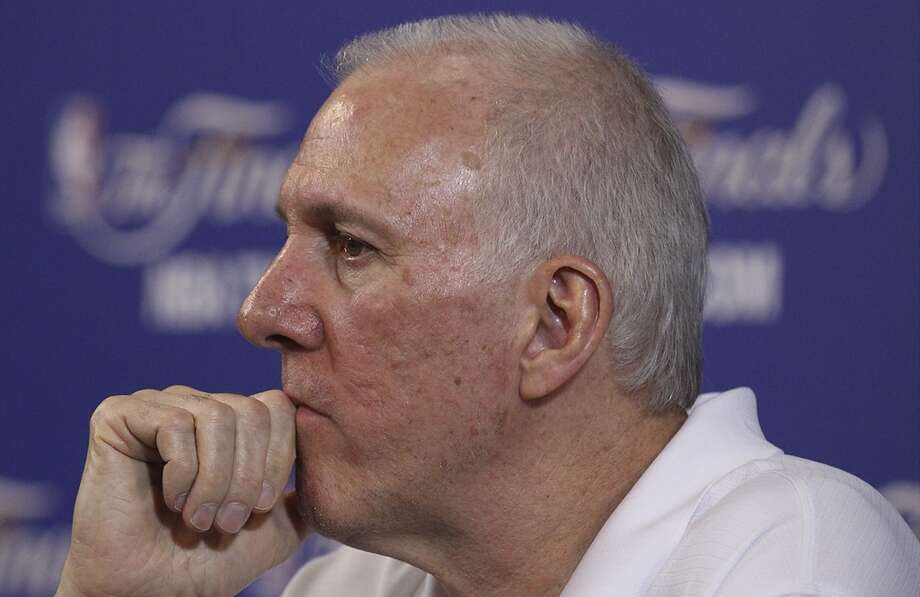 Spurs coach Gregg Popovich listens to questions during practice and media sessions at the American Airlines Arena in Miami on Saturday, June 8, 2013. (Kin Man Hui / San Antonio Express-News)