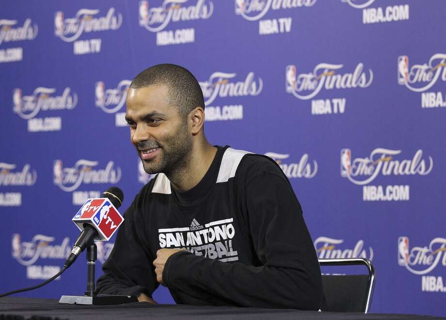 Spurs guard Tony Parker smiles as he starts his practice and media sessions at the American Airlines Arena in Miami on Saturday, June 8, 2013. (Kin Man Hui / San Antonio Express-News)