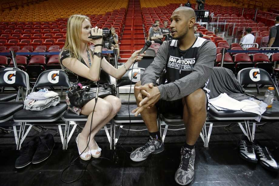 San Antonio Spurs center Boris Diaw, right, of France, is interviewed before basketball practice on Saturday, June 8, 2013, at the American Airlines Arena in Miami. The Miami Heat and the Spurs are to play Game 2 of the NBA Finals, Sunday. (Wilfredo Lee / Associated Press)