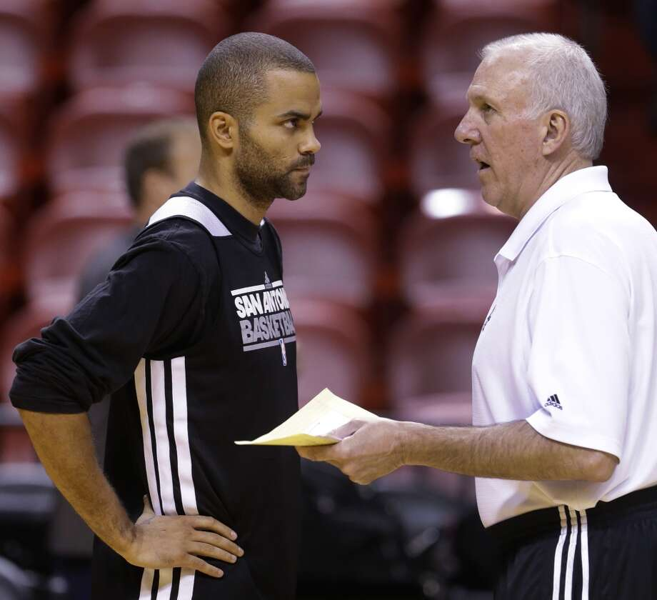 San Antonio Spurs point guard Tony Parker, left, of France, talks with head coach Gregg Popovich during basketball practice, Saturday, June 8, 2013, at the American Airlines Arena in Miami. The Miami Heat and the Spurs are to play Game 2 of the NBA Finals, Sunday. (Wilfredo Lee / Associated Press)