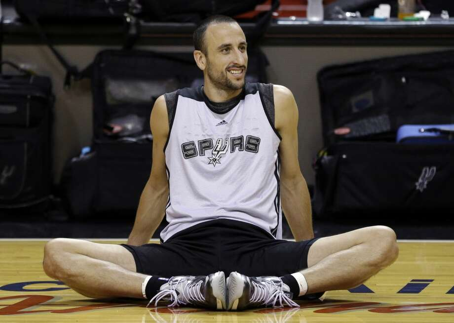 San Antonio Spurs shooting guard Manu Ginobili, of Argentina, stretches during basketball practice on Saturday, June 8, 2013, at the American Airlines Arena in Miami. The Miami Heat and the Spurs are to play Game 2 of the NBA Finals, Sunday. (Wilfredo Lee / Associated Press)