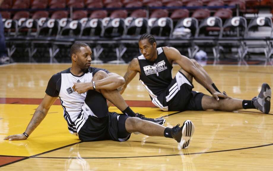 San Antonio Spurs guard Tracy McGrady, foreground, and forward Kawhi Leonard stretch during basketball practice, Saturday, June 8, 2013, in Miami. The Miami Heat and the Spurs play Game 2 of the NBA Finals on Sunday. (Wilfredo Lee / Associated Press)
