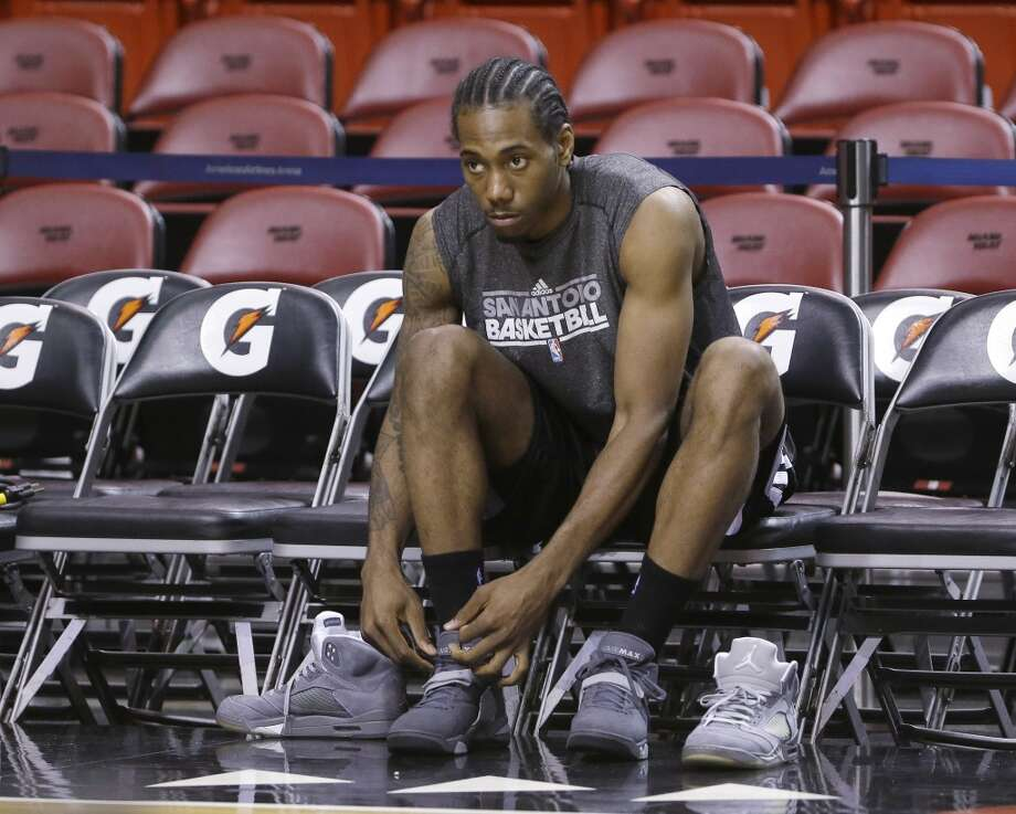 San Antonio Spurs small forward Kawhi Leonard changes shoes before basketball practice on Saturday, June 8, 2013, at the American Airlines Arena in Miami. The Miami Heat and the Spurs are to play Game 2 of the NBA Finals, Sunday. (Wilfredo Lee / Associated Press)