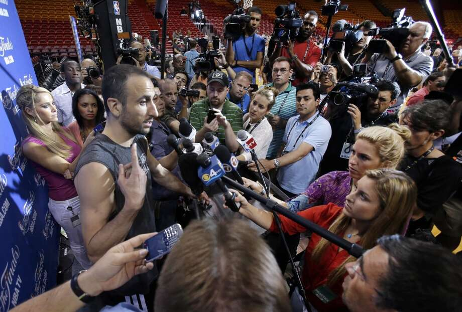 San Antonio Spurs guard Manu Ginobili, of Argentina, gestures as he speaks to members of the media before NBA basketball practice, Saturday, June 8, 2013 at the American Airlines Arena in Miami. The Miami Heat and the Spurs play in  Game 2 of the NBA Finals on Sunday. (Wilfredo Lee / Associated Press)