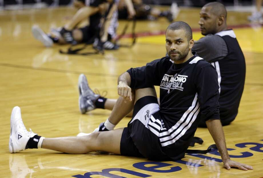 San Antonio Spurs point guard Tony Parker, of France, stretches during basketball practice on Saturday, June 8, 2013, at the American Airlines Arena in Miami. The Miami Heat and the Spurs are to play Game 2 of the NBA Finals, Sunday. (Wilfredo Lee / Associated Press)