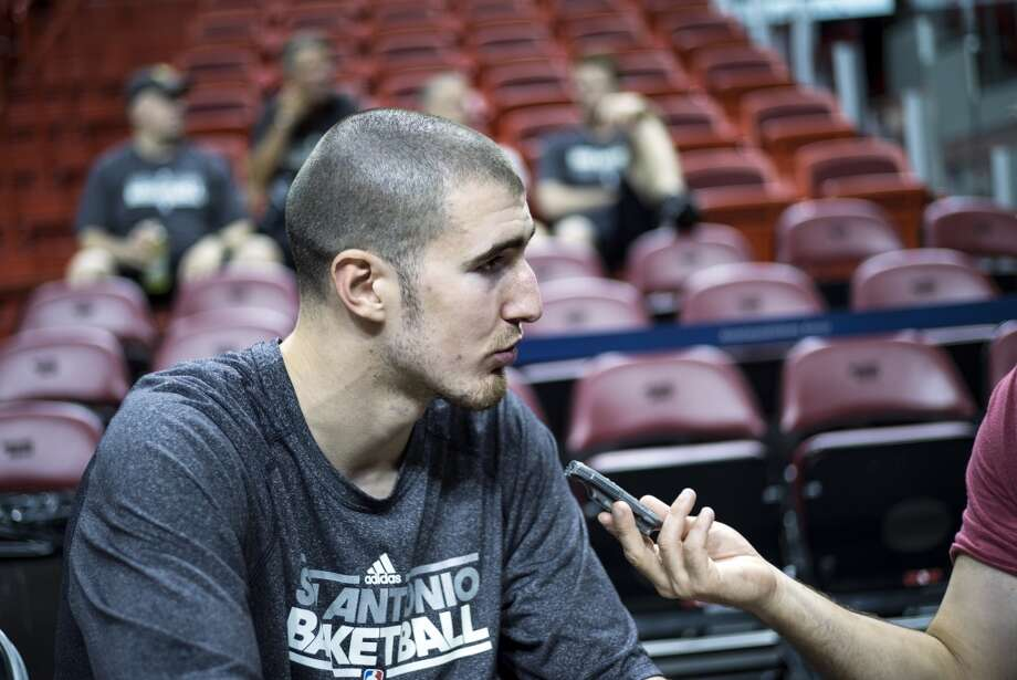 Frenchman Nando De Colo of the San Antonio Spurs is interviewed before a practice session for Game 2 of the NBA Finals at the American Airlines Arena on June 8, 2013 in Miami. The San Antonio Spurs won Game 1 against the Miami Heat 92-88. (Brendan Smialowski / AFP / Getty Images)