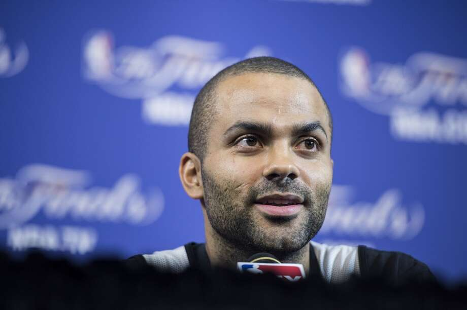 Frenchman Tony Parker of the San Antonio Spurs speaks to reporters before a practice session for Game 2 of the NBA Finals at the American Airlines Arena on June 8, 2013 in Miami. The San Antonio Spurs won Game 1 against the Miami Heat 92-88. (Brendan Smialowski / AFP / Getty Images)