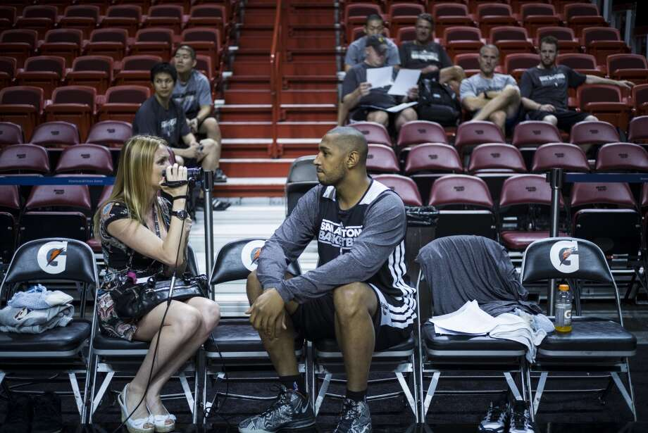 Frenchman Boris Diaw of the San Antonio Spurs is interviewed before a practice session for Game 2 of the NBA Finals at the American Airlines Arena on June 8, 2013 in Miami. The San Antonio Spurs won Game 1 against the Miami Heat 92-88. (Brendan Smialowski / AFP / Getty Images)