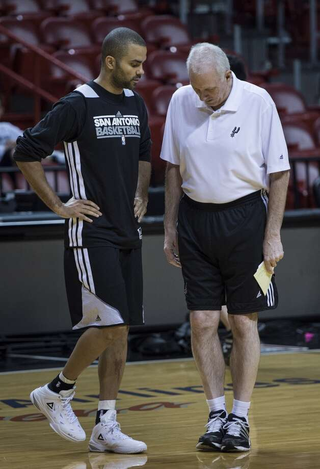 Frenchman Tony Parker (L) of the San Antonio Spurs and Spurs head coach Gregg Popovich talk during a practice session for Game 2 of the NBA Finals at the American Airlines Arena on June 8, 2013 in Miami. The San Antonio Spurs won Game 1 against the Miami Heat 92-88. (Brendan Smialowski / AFP / Getty Images)