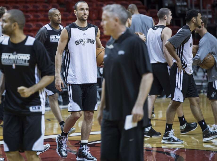 Argentine Manu Ginobili of the San Antonio Spurs stands with teammates during a practice session for Game 2 of the NBA Finals at the American Airlines Arena on June 8, 2013 in Miami. The San Antonio Spurs won Game 1 against the Miami Heat 92-88. (Brendan Smialowski / AFP / Getty Images)