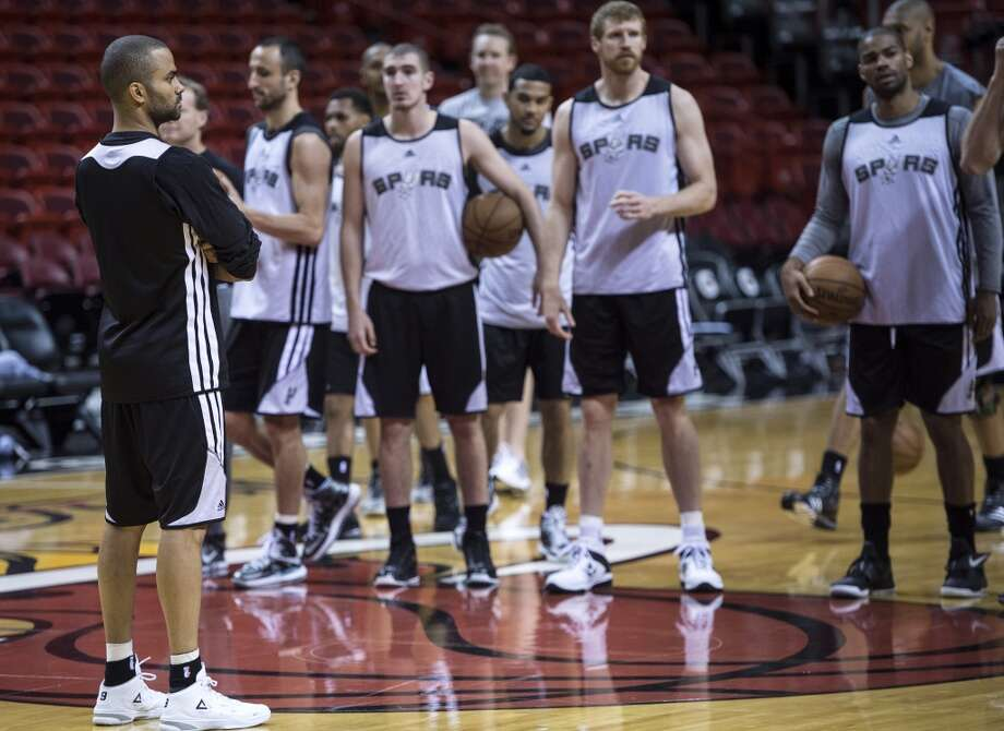 Frenchman Tony Parker (L) of the San Antonio Spurs stands with teammates before a practice session for Game 2 of the NBA Finals at the American Airlines Arena on June 8, 2013 in Miami. The San Antonio Spurs won Game 1 against the Miami Heat 92-88. (Brendan Smialowski / AFP / Getty Images)