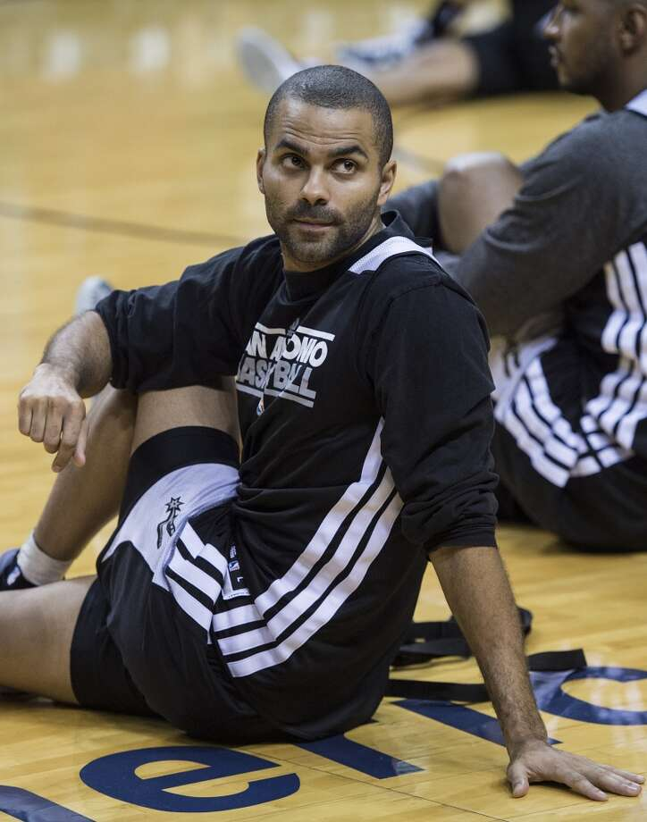 Frenchman Tony Parker of the San Antonio Spurs stretches during a practice session for Game 2 of the NBA Finals at the American Airlines Arena on June 8, 2013 in Miami. The San Antonio Spurs won Game 1 against the Miami Heat 92-88.   AFP PHOTO/Brendan SMIALOWSKIBRENDAN SMIALOWSKI/AFP/Getty Images