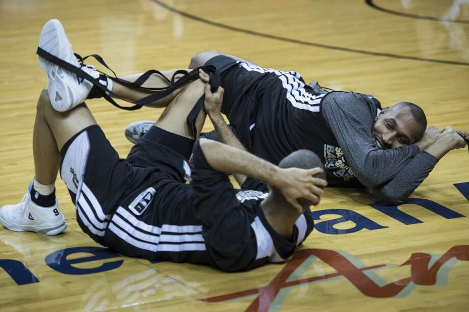 Frenchmen Tony Parker (L) and Boris Diaw of the San Antonio Spurs talk while stretching during a practice session for Game 2 of the NBA Finals at the American Airlines Arena on June 8, 2013 in Miami. The San Antonio Spurs won Game 1 against the Miami Heat 92-88.   AFP PHOTO/Brendan SMIALOWSKIBRENDAN SMIALOWSKI/AFP/Getty Images