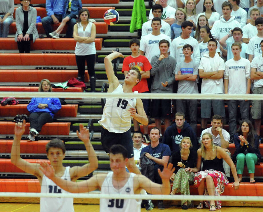Staples' Lucas Grevers serves the ball, during Class L volleyball finals action against Glastonbury in Shelton, Conn. on Friday June 7, 2013. Photo: Christian Abraham / Connecticut Post