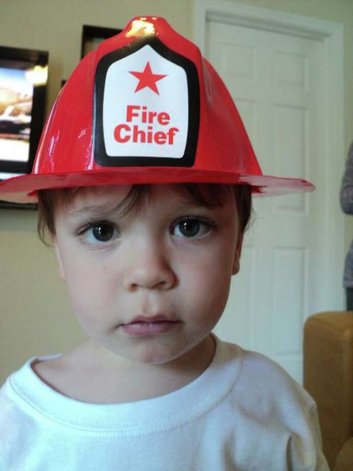 Emmett Robichaud, son of Brenda and Michael Robichaud of Rensselaer, sports his fireman's hat for his second birthday party this spring.  The rain didn't stop the festivities, says his great aunt Lynne Beiermeister of Voorheesville, who snapped his photo. (Lynne Beiermeister)