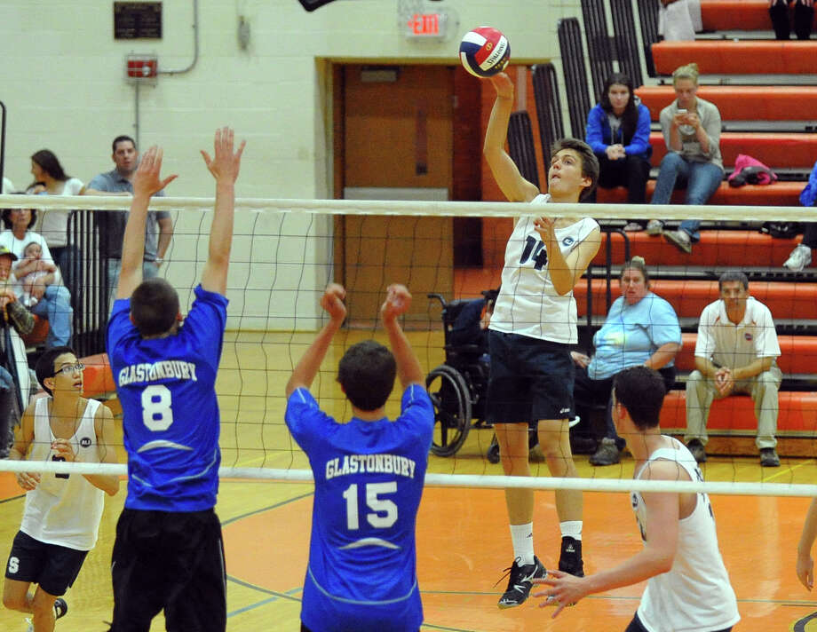 Staples' Lucas Carstens taps the ball back over to Glastonbury, during Class L volleyball finals action in Shelton, Conn. on Friday June 7, 2013. Photo: Christian Abraham / Connecticut Post