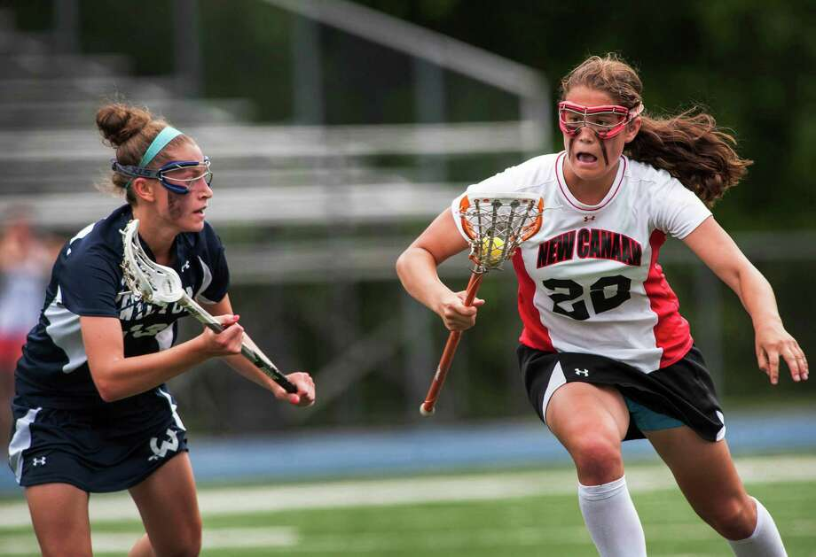 New Canaan high school's Olivia Hompe tries to get by Wilton high school's Makenna Pearsall duirnig the CIAC division M girls lacrosse championship game played at Bunnell high school, Stratford, CT on Saturday June 8th, 2013. Photo: Mark Conrad / Stamford Advocate Freelance