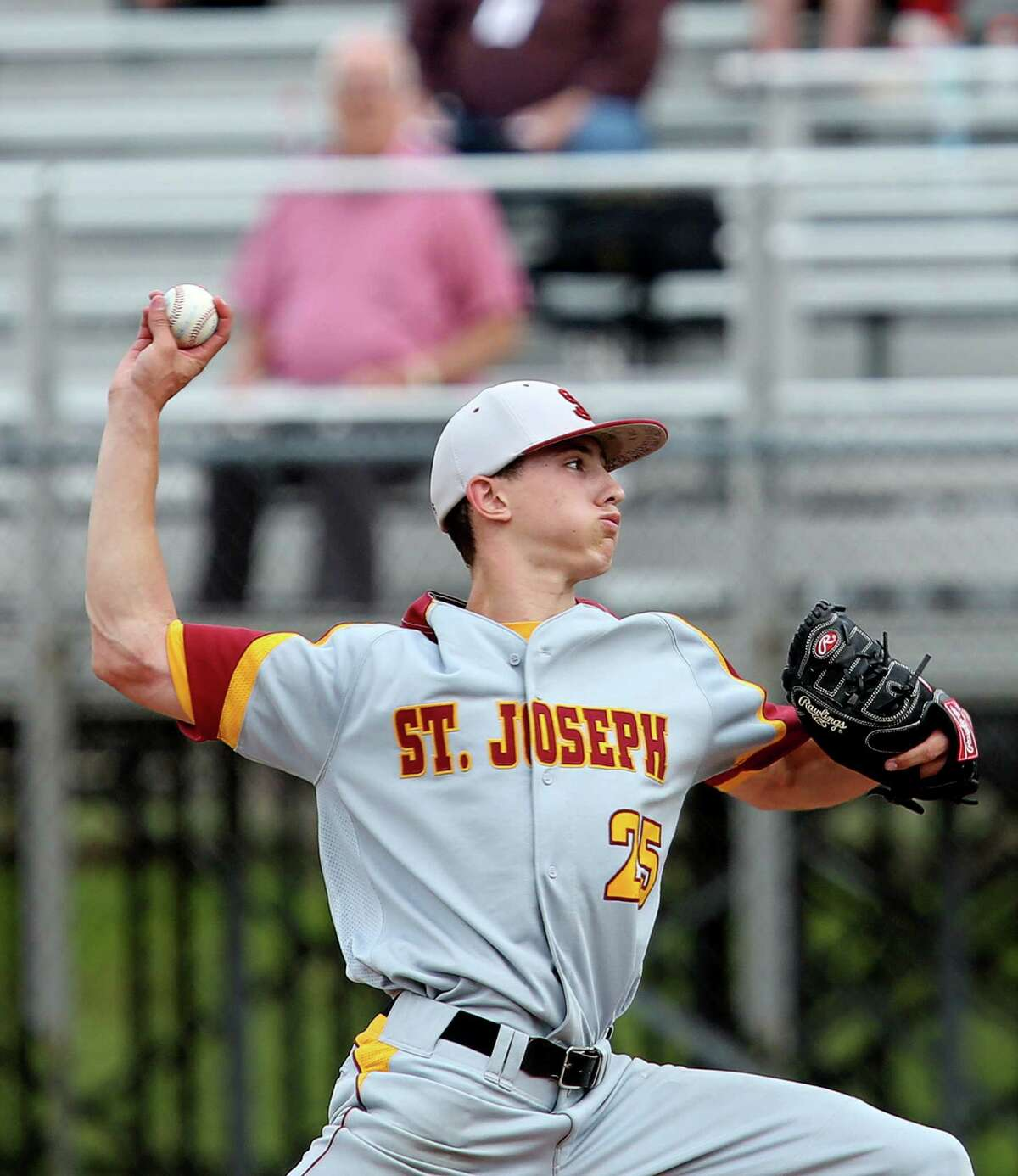 Mike Ross Connecticut Post freelance -St.Joseph's pitcher # 25 Nick Williams delivers his pitch during Saturday afternoon Class M Finals against Northwestern in Middletown's Palmer Field. St. Joseph would win 2-1.