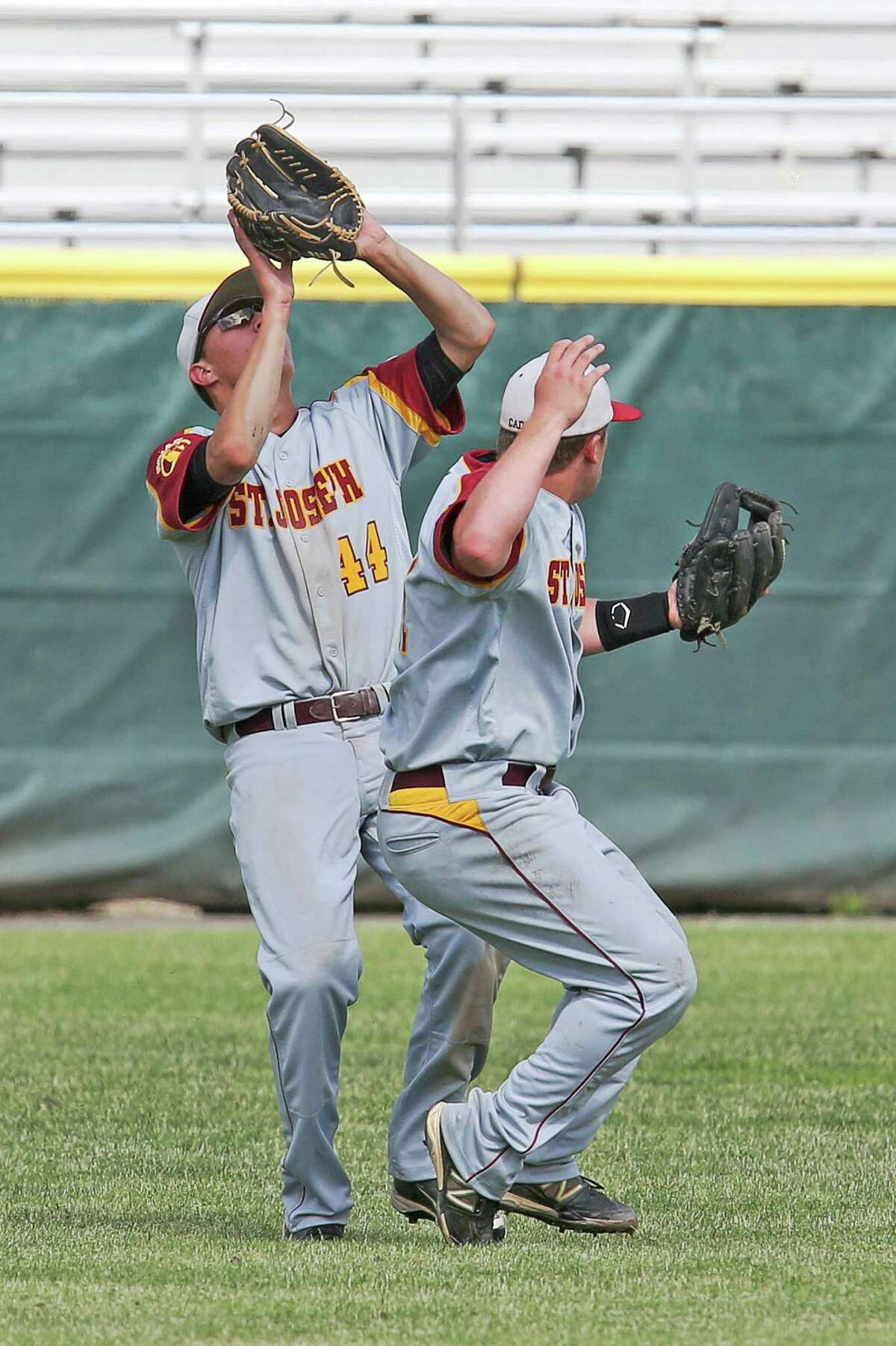 Mike Ross Connecticut Post freelance -St.Joseph's # 44 Jake Amoroso and #11 Mark Hirschbeck escape the collision and Amoroso makes the out to retire the inning during Saturday afternoon Class M Finals against Northwestern. St. Joseph would win 2-1.
