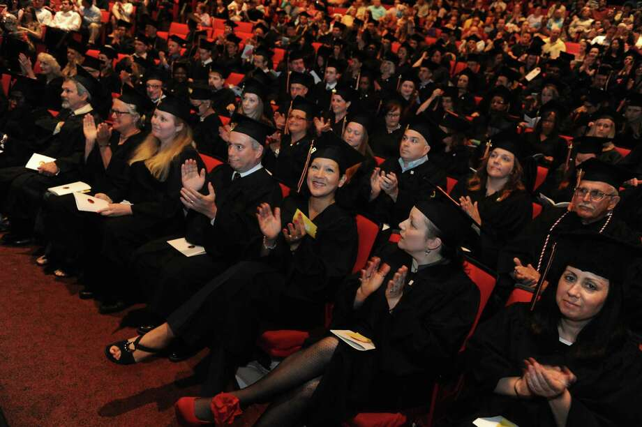Graduates listen to speakers during the Empire State College Northeast Center graduation commencement at the Egg on Saturday June 8, 2013 in Albany, N.Y. (Michael P. Farrell/Times Union) Photo: Michael P. Farrell
