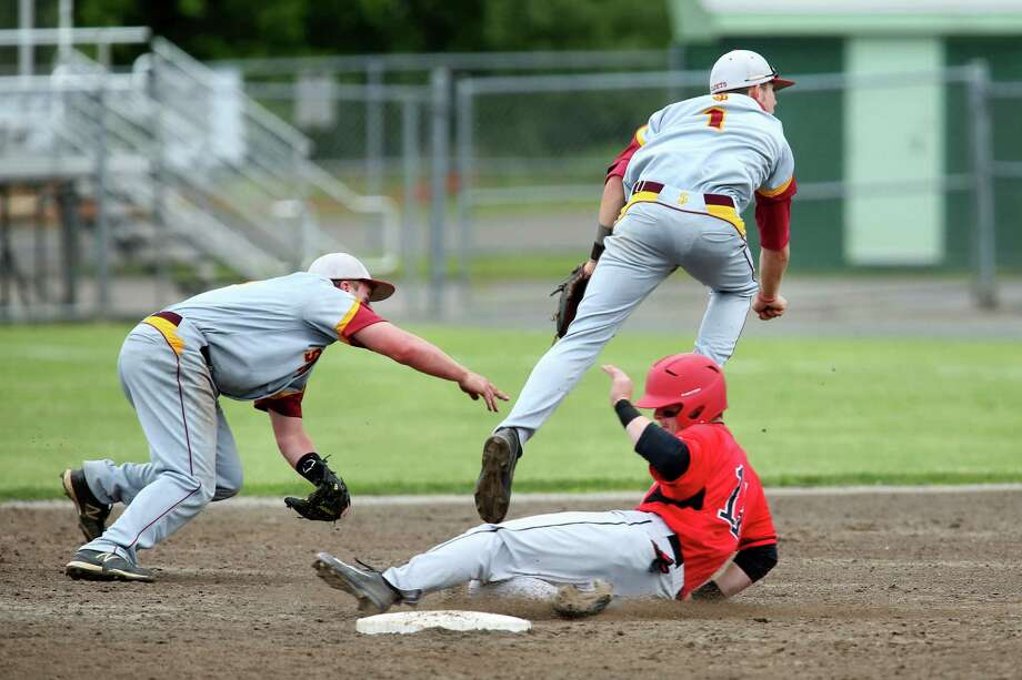 Mike Ross Connecticut Post freelance -St.Joseph's # 1 Matt Batten makes the throw to firstbase after getting a assist from teammate # 11 Mark Hirschbeck on a double play during Saturday afternoon's Class M Finals against Northwestern. St. Joseph would win 2-1. Photo: Mike Ross / Mike Ross Connecticut Post freelance - @www.mikerossphoto.com