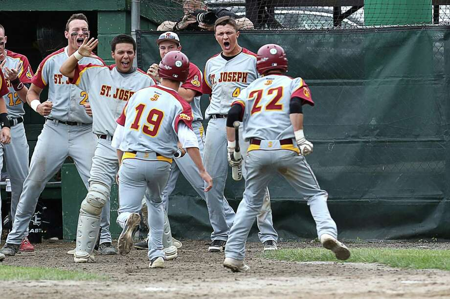 Mike Ross Connecticut Post freelance -St.Joseph's dugout celebrates teammate #19 Matt Laveneziana after Laveneziana's score on homeplate to add to the lead during Saturday afternoon's Class M Finals against Northwestern. St. Joseph would win 2-1. Photo: Mike Ross / Mike Ross Connecticut Post freelance - @www.mikerossphoto.com