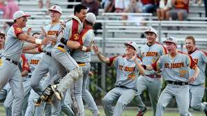 Mike Ross Connecticut Post freelance -St.Joseph players rush the mound in celebration of Saturday Class M Finals 2-1 win against Northwestern at Palmer Field in Middeltown.
