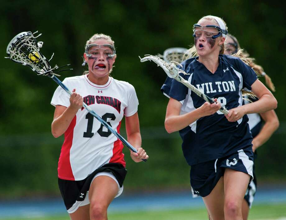 Wilton high school's Laura Knapp (right) tries to catch up to New Canaan high school's Wheatley Raabe during the CIAC division M girls lacrosse championship game played at Bunnell high school, Stratford, CT on Saturday June 8th, 2013. Photo: Mark Conrad / Stamford Advocate Freelance