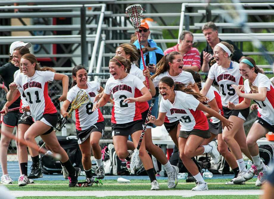 New Canaan high school team runs onto the field after defeating Wilton high school in the CIAC division M girls lacrosse championship game played at Bunnell high school, Stratford, CT on Saturday June 8th, 2013. Photo: Mark Conrad / Stamford Advocate Freelance