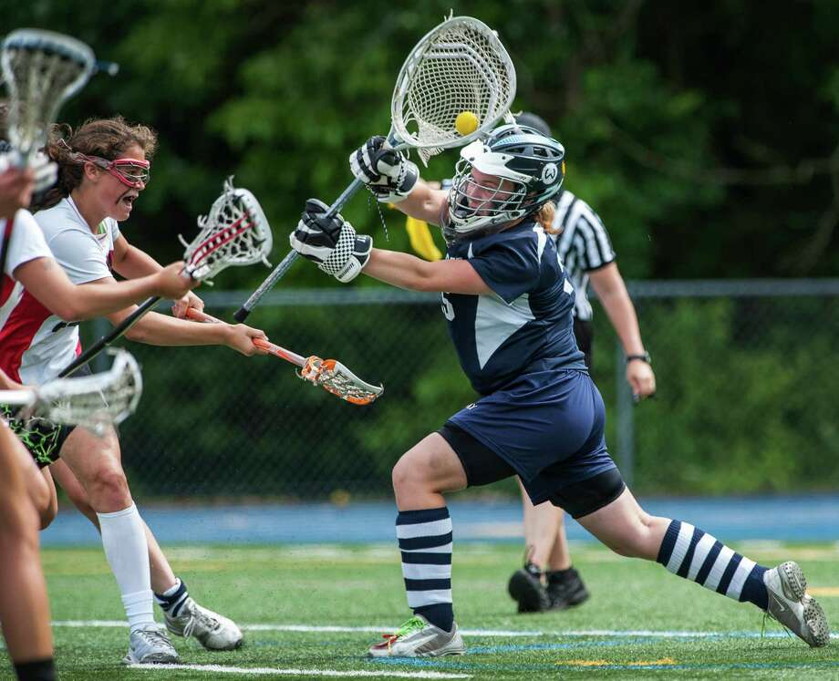 Wilton high school goalie Hannah Wiltshire makes a save on a shot by Olivia Hompe durinig the CIAC division M girls lacrosse championship game against New Canaan high school played at Bunnell high school, Stratford, CT on Saturday June 8th, 2013. Photo: Mark Conrad / Stamford Advocate Freelance