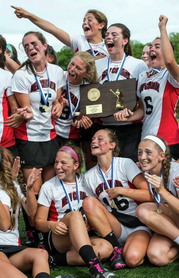 The New Canaan high school girls lacrosse team celebrate wnning the CIAC division M girls lacrosse championship game against Wilton high school played at Bunnell high school, Stratford, CT on Saturday June 8th, 2013. Photo: Mark Conrad / Stamford Advocate Freelance