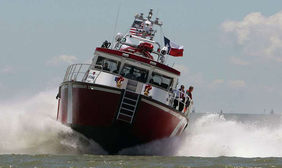 A view of the Port of Houston's newest fireboat FB2 during a demonstration near Barbours Cut Tuesday, June 4, 2013, in Houston. Photo: James Nielsen, Houston Chronicle / © 2013  Houston Chronicle