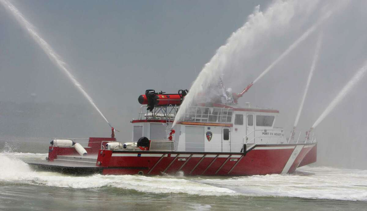 The Port of Houston's newest fireboat FB2 spray water from it's fire monitors during a demonstration near Barbours Cut Tuesday, June 4, 2013, in Houston.