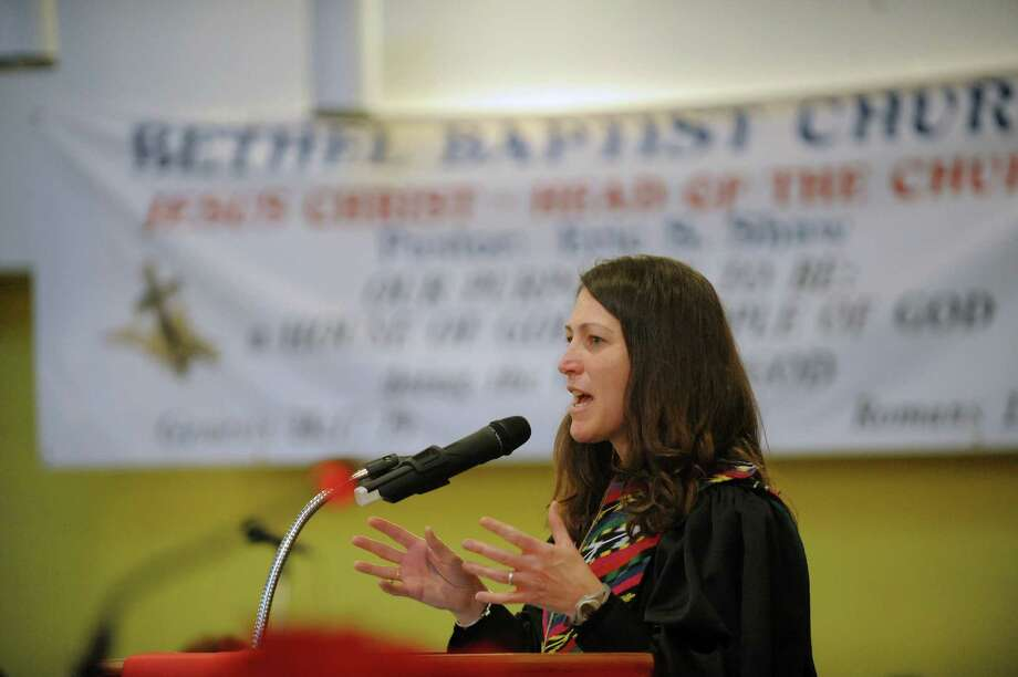 The Rev. Nina Nichols, pastor of Christ Church United Methodist, addresses those gathered for an interfaith worship service at Bethel Baptist Church to celebrate the Rev. Dr. Martin Luther king, Jr. on Sunday, Jan. 20, 2013 in Troy, NY.  The offering at the service raised money for the Rev. Dr. Martin Luther king, Jr. Scholarship Fund for Troy area youth or adults who wish to pursue advanced education.  Over $1,800 was raised through the offering. (Paul Buckowski / Times Union) Photo: Paul Buckowski / 00020780A