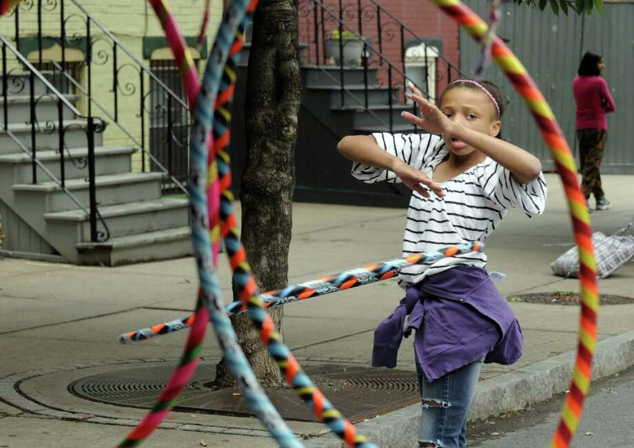 Ten-year-old Qesciyh Chandler of Albany hula hoops during Art on Lark Saturday June 8, 2013 in Albany, N.Y.  (Michael P. Farrell/Times Union) Photo: Michael P. Farrell