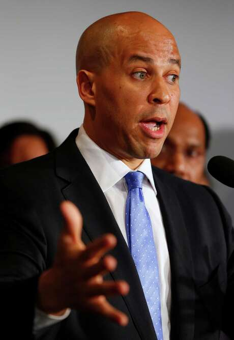 Newark Mayor Cory Booker announces his plans to run for the U.S. Senate seat that opened with the death of Frank Lautenberg (D-N.J.) in Newark, N.J. on Saturday, June 8, 2013. Booker, 44, is currently serving in his second term as mayor. (AP Photo/Rich Schultz) Photo: Rich Schultz, FRE / FR27227 AP