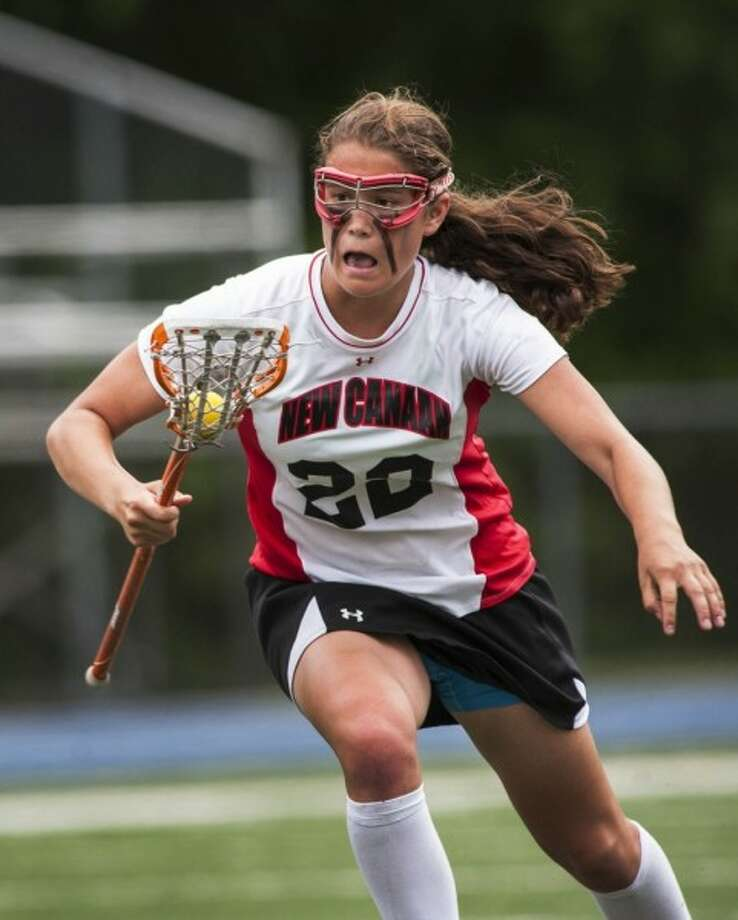 Olivia Hompe makes a run during her final game in a New Canaan uniform.