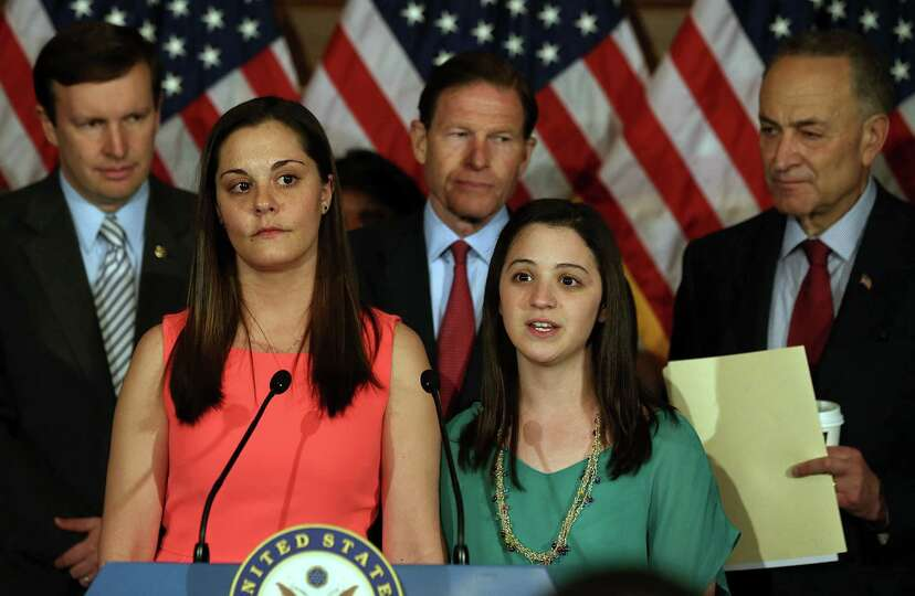 WASHINGTON, DC - APRIL 11: Erica Lafferty (2nd-L) and Jillian Soto (2nd-R), who both lost family mem