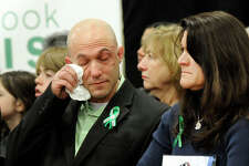 Jeremy Richman and Jennifer Hensel, parents of Avielle, one of the children killed in the Sandy Hook Elementary School shootings, participate in a press conference Monday morning at the Edmond Town Hall, for a grassroots initiative to end gun violence, Sandy Hook Promise, January 14, 2013.
