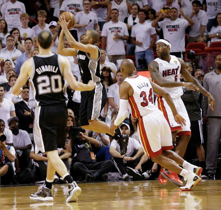 Spurs point guard Tony Parker, center, gave fans an early indelible image with his circus shot at the end of a Game 1 win over the Heat to open the NBA Finals. Photo: Lynne Sladky, STF / AP