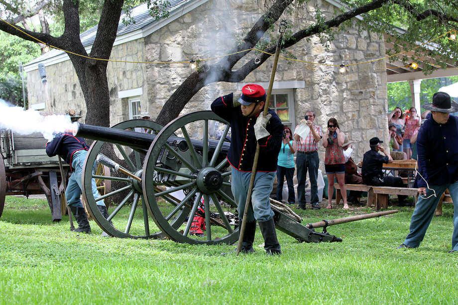 Actors dressed in 1866 2nd U.S. Artillery uniforms fire a Civil War era replica cannon on the grounds of the Institute of Texan Cultures on June 8, 2013. Photo: TOM REEL