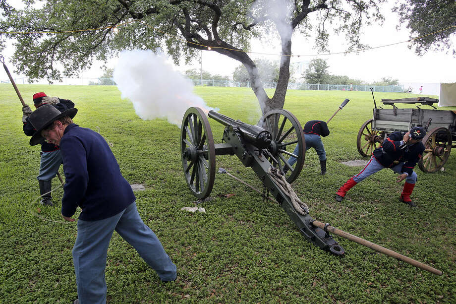 Re-enactors dressed like soldiers in the 1866 2nd U.S. Artillery fire a Civil War-era replica cannon on the grounds of the Institute of Texan Cultures at the 42nd annual Texas Folklife Festival. Photo: Photos By Tom Reel / San Antonio Express-News