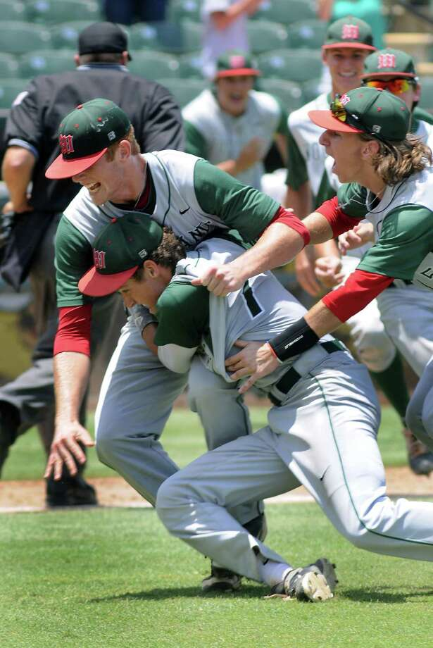 The Woodlands' Carter Hope (left photo) was on target Saturday, pitching a two-hitter and leading the Highlanders to a 9-5 victory over Dulles and the Class 5A state championship that he celebrated with teammates Luke Shirley and Hillin Warren (right photo) after getting the final out in the bottom of the seventh inning. Photo: Jerry Baker, Freelance